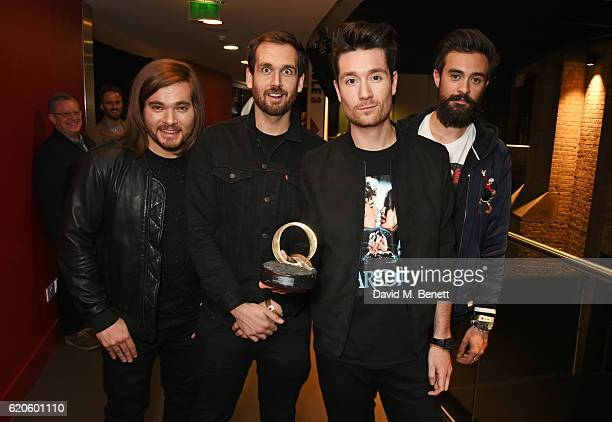 Chris 'Woody' Wood William Farquarson Dan Smith and Kyle J Simmons of Bastille winners of the Q Best Track award for Good Grief pose at The Stubhub Q...