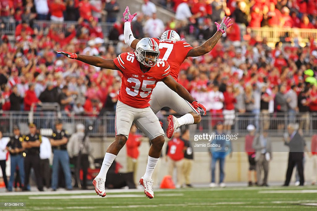 Chris Worley #35 of the Ohio State Buckeyes and Damon Webb #7 of the Ohio State Buckeyes celebrate after stopping the Indiana Hoosiers on fourth down near the goal line in the fourth quarter at Ohio Stadium on October 8, 2016 in Columbus, Ohio. Ohio State defeated Indiana 38-17.