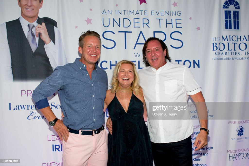 Chris Wragge, Debra Halpert and Lawrence Scott attend An Intimate Evening Under The Stars With Michael Bolton at Private Residence on August 19, 2017 in Bridgehampton, New York.