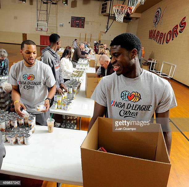 Chris Wright and Adrian Thomas of the Bakersfield Jam help fill Thanksgiving food boxes during the Bakersfield Jam Thanksgiving Box Give Away Event...