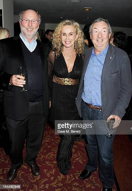 Chris Wright Angie Rutherford and Nick Mason celebrate backstage after the We Will Rock You 10 Year Anniversary performance at The Dominion Theatre...