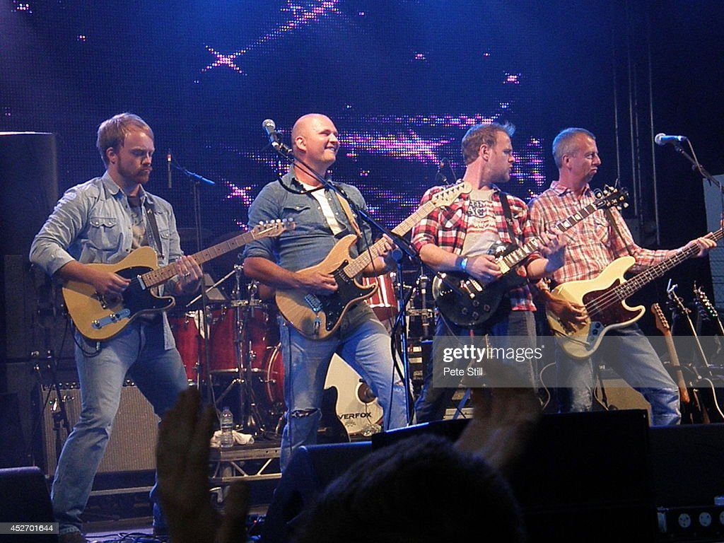 Chris Wright, Christian Phillips, Michael Lawrence and Chris Childs of The Eagles tribute band Ultimate Eagles perform on stage at Silverstone Classic at Silverstone on July 25, 2014 in Northampton, United Kingdom.
