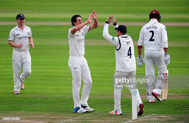 Chris Wright of Warwickshire celebrates after dismissing Marcus Trescothick of Somerset during Day One of the Specsavers County Championship Division...