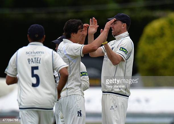 Chris Wright of Warwickshire celebrates taking the wicket of Richard Oliver of Worcestershiredduring the LV County Championship match between...