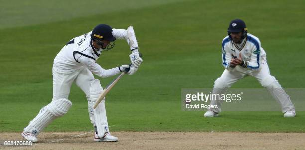 Chris Wright of Warwickshire plays the ball during the Specsavers County Championship One match between Warwickshire and Yorkshire at Edgbaston on...