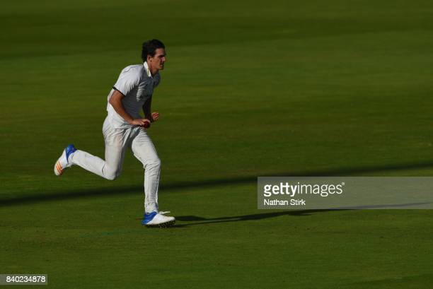 Chris Wright of Warwickshire runs into bowl during the County Championship Division One match between Lancashire and Warwickshire at Old Trafford on...
