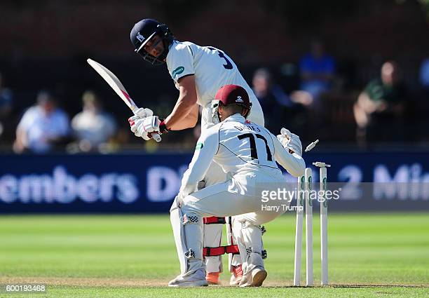 Chris Wright of Warwickshire survives a stumping chance from Ryan Davies of Somerset during Day Three of the Specsavers County Championship Division...