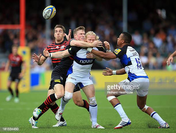 Chris Wyles claims a loose ball as Chris Ashton of Saracens tackles Tom Biggs of Bath during the Aviva Premiership Rugby match between Saracens and...