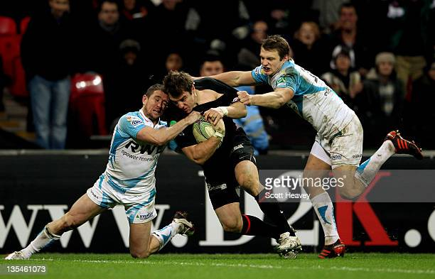 Chris Wyles of Saracens beats Shane Williams and Dan Biggar of Ospreys to score a try during the Heineken Cup Match between Saracens and Ospreys at...