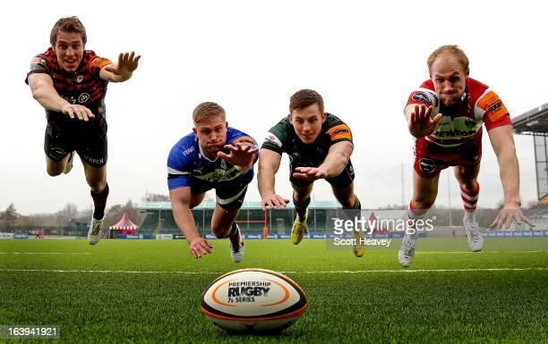 Chris Wyles of Saracens Ben Williams of Bath Josh Shipley of Northampton and Olly Morgan of Gloucetser dive for the ball during the launch of the...