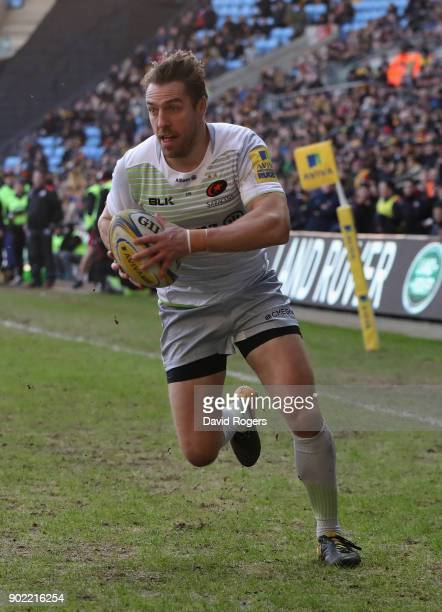 Chris Wyles of Saracens breaks clear to score the first try during the Aviva Premiership match between Wasps and Saracens at The Ricoh Arena on...