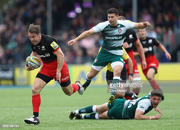 Chris Wyles of Saracens breaks through to score a try during the Aviva Premiership semi final match between Saracens and Leicester Tigers at Allianz...