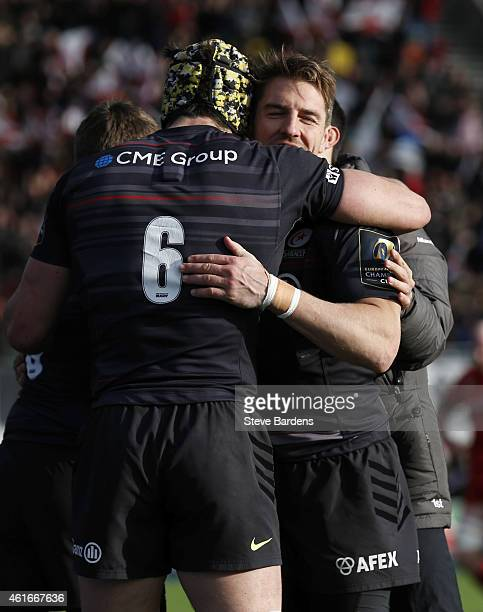 Chris Wyles of Saracens celebrates scoring a try with Kelly Brown during the European Rugby Champions Cup pool one match between Saracens and Munster...