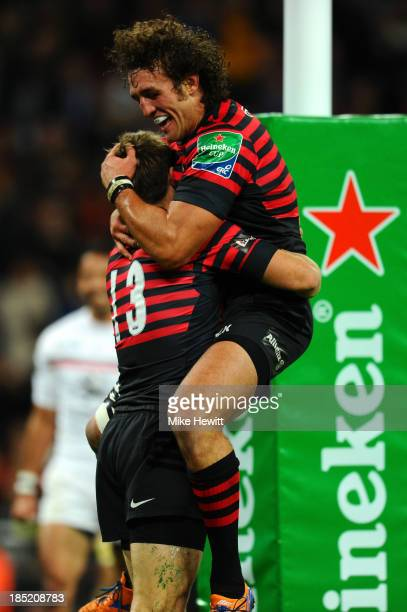 Chris Wyles of Saracens icongratulated by teammate Jacques Burger after scoring the opening try during the Heineken Cup pool three match between...