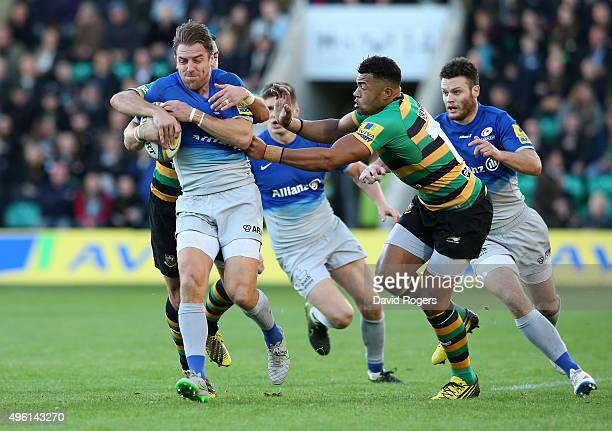 Chris Wyles of Saracens is tackled by Luther Burrell during the Aviva Premiership match between Northampton Saints and Saracens at Franklin's Gardens...