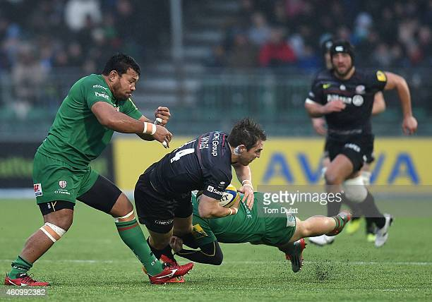 Chris Wyles of Saracens is tackled by Ofisa Treviranus of London Irish during the Aviva Premiership match between Saracens and London Irish at...