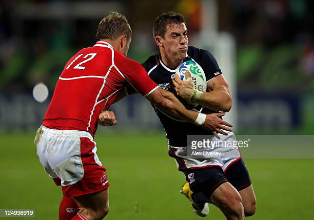 Chris Wyles of USA is tackled by Alexey Makovetskiy of Russia during the IRB 2011 Rugby World Cup Pool C match between Russia and the USA at Stadium...