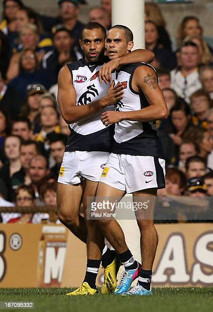 Chris Yarran and Jeff Garlett of the Blues celebrate a goal during the round four AFL match between the West Coast Eagles and the Carlton Blues at...