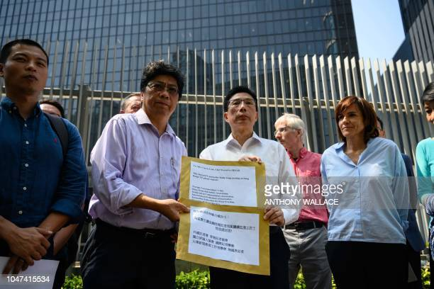 Chris Yeung Chairperson of the Hong Kong Journalist Association stands next to an unnamed government representative and Foreign Correspondents' Club...