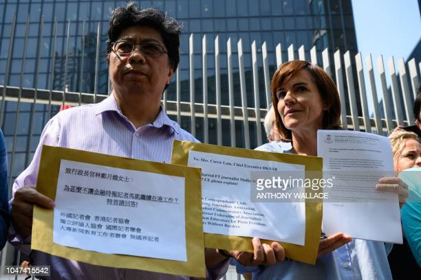 Chris Yeung Chairperson of the Hong Kong Journalist Association stands next to Foreign Correspondents' Club president Florence de Changy as they...