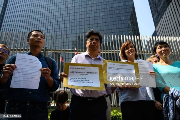 Chris Yeung Chairperson of the Hong Kong Journalist Association stands next to Foreign Correspondents' Club president Florence de Changy and...