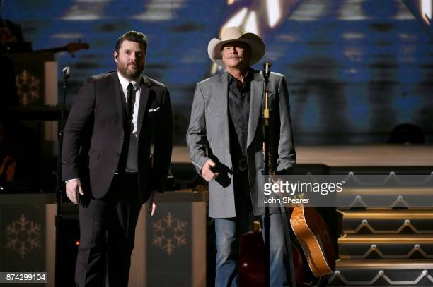 Chris Young and Alan Jackson perform onstage for CMA 2017 Country Christmas at The Grand Ole Opry on November 14 2017 in Nashville Tennessee