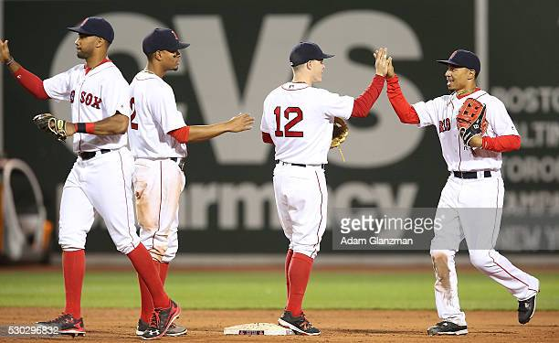 Chris Young Brock Holt Mookie Betts and Xander Bogaerts celebrate after their victory over the Oakland Athletics at Fenway Park on May 10 2016 in...