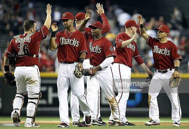 Chris Young Justin Upton and Gerardo Parra of the Arizona Diamondbacks celebrate with teammates after defeating the Pittsburgh Pirates in the Major...