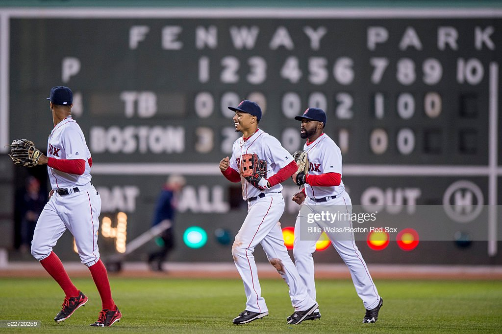Chris Young #30, Mookie Betts #50, and Jackie Bradley Jr. #25 react after defeating the Tampa Bay Rays on April 20, 2016 at Fenway Park in Boston, Massachusetts .