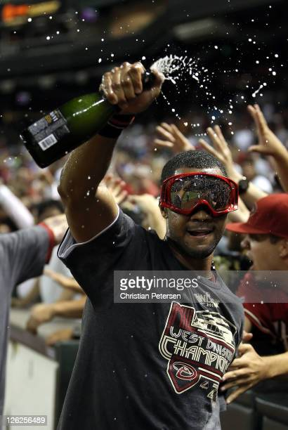 Chris Young of the Arizona Diamondbacks celebrates with champagne after defeating the San Francisco Giants and clinching the National League West...