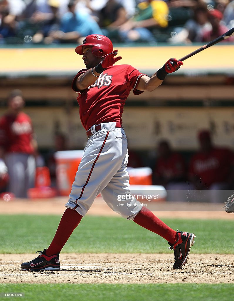 Chris Young #24 of the Arizona Diamondbacks hits an RBI single against the Oakland Athletics at Oakland-Alameda County Coliseum on July 3, 2011 in Oakland, California.