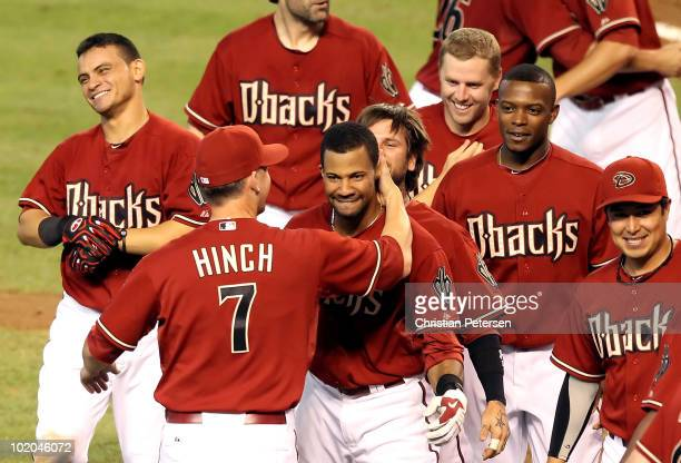 Chris Young of the Arizona Diamondbacks is congratulated by manager AJ Hinch after hitting a walk off 2 run home run against the St Louis Cardinals...
