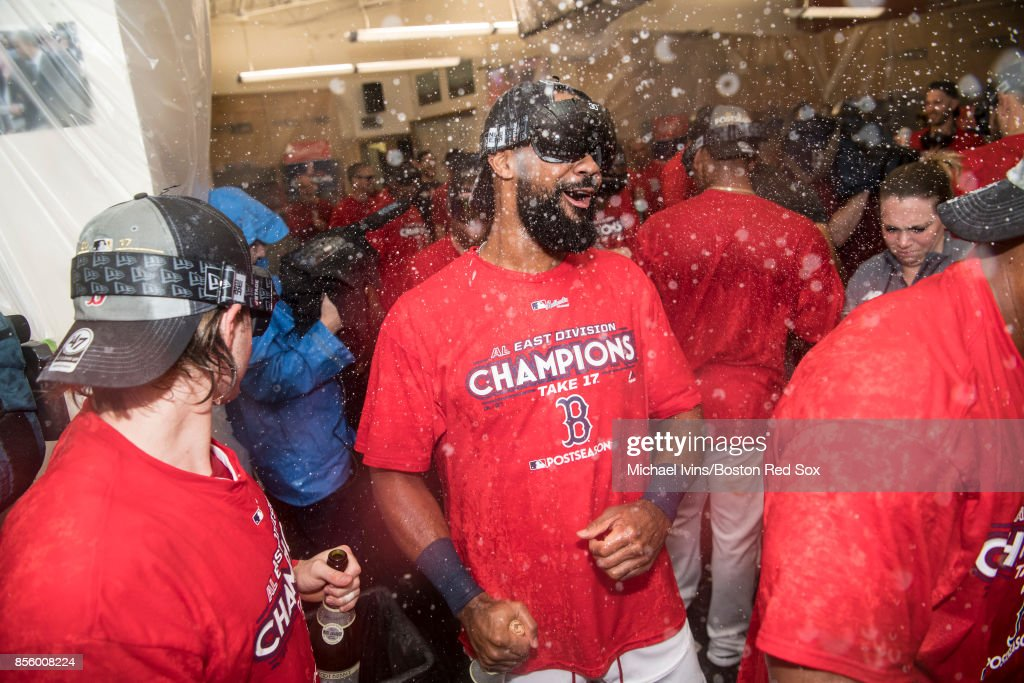 Chris Young #30 of the Boston Red Sox celebrates after the team clinched the American League East pennant with a win over the Houston Astros at Fenway Park on September 30, 2017 in Boston, Massachusetts.