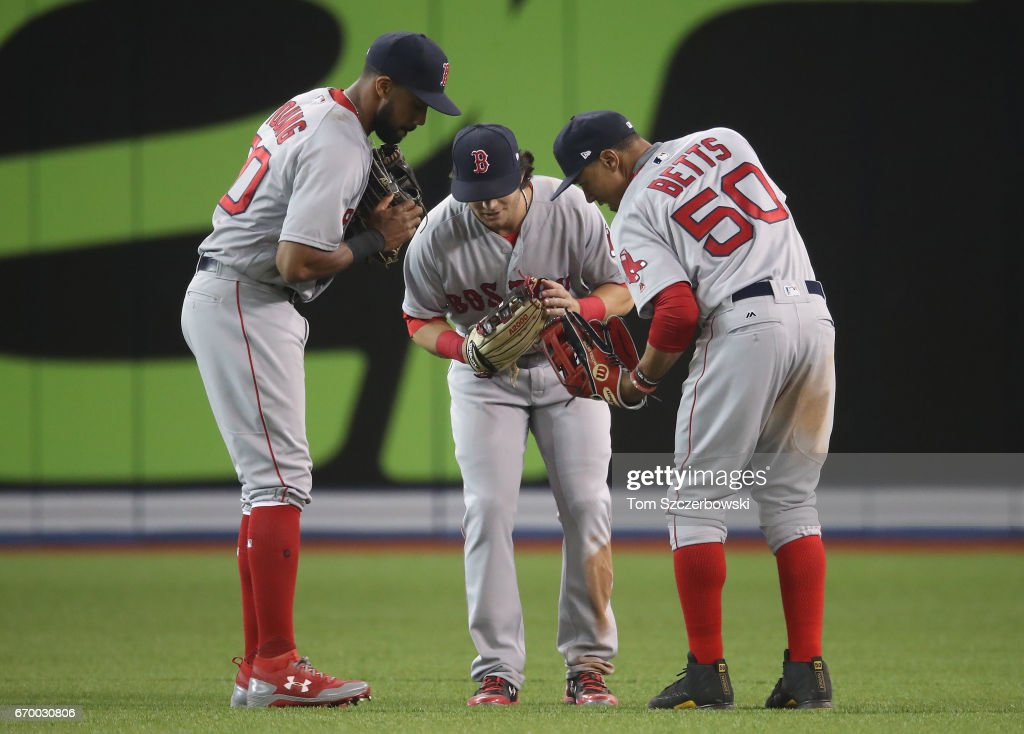 Chris Young #30 of the Boston Red Sox celebrates their victory with Andrew Benintendi #16 and Mookie Betts #50 during MLB game action against the Toronto Blue Jays at Rogers Centre on April 18, 2017 in Toronto, Canada.