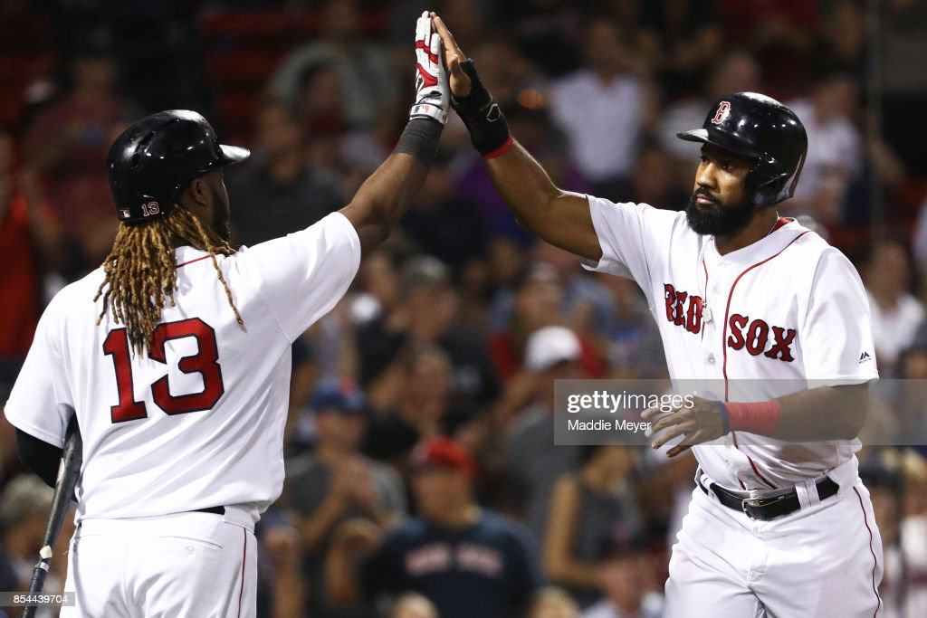 Chris Young #30 of the Boston Red Sox celebrates with Hanley Ramirez #13 after scoring a run against the Toronto Blue Jays during the eighth inning at Fenway Park on September 26, 2017 in Boston, Massachusetts.
