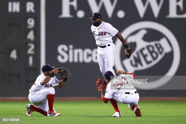 Chris Young of the Boston Red Sox Mookie Betts and Jackie Bradley Jr #19 celebrate in the outfield after defeating the St Louis Cardinals 104 at...