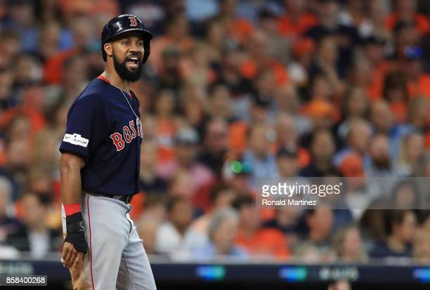 Chris Young of the Boston Red Sox reacts after scoring a run in the second inning against the Houston Astros during game two of the American League...