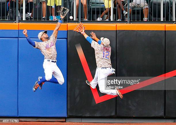 Chris Young of the New York Mets and teamate Juan Lagares are unable to catch a triple off the bat of Hunter Pence of the San Francisco Giants at...