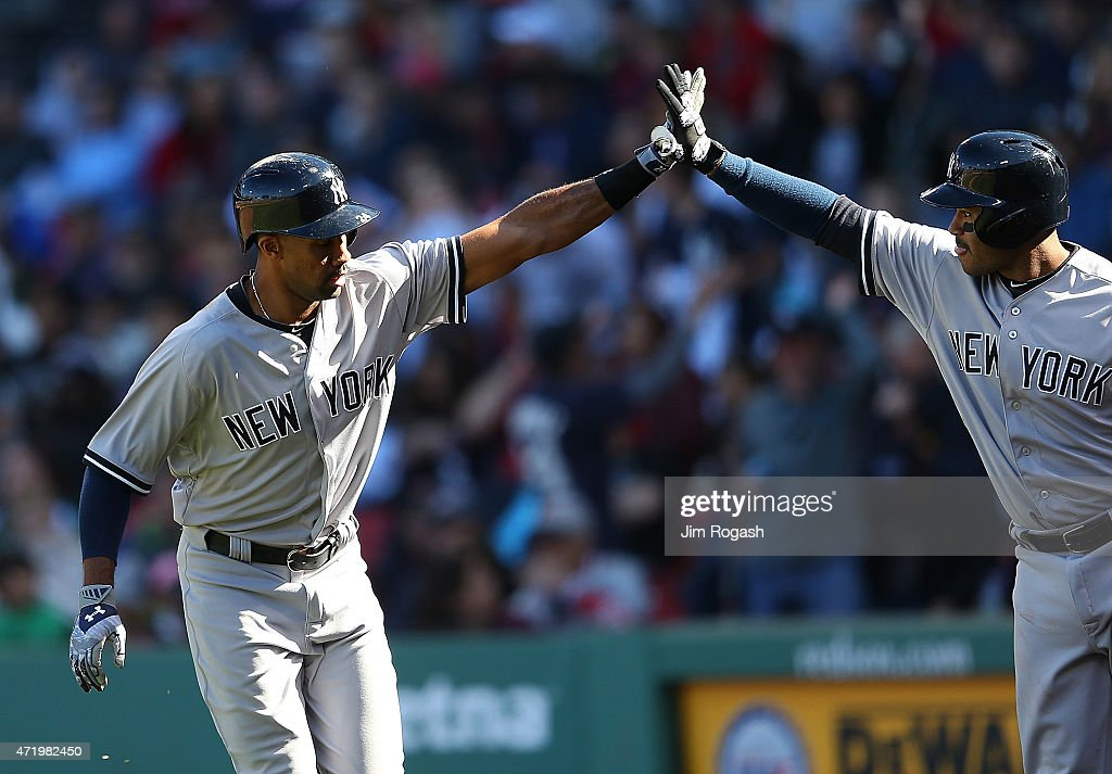 Chris Young #24 of the New York Yankees celebrates his home run with Gregorio Petit #31 in the ninth inning against the Boston Red Sox at Fenway Park May 2, 2015 in Boston, Massachusetts.