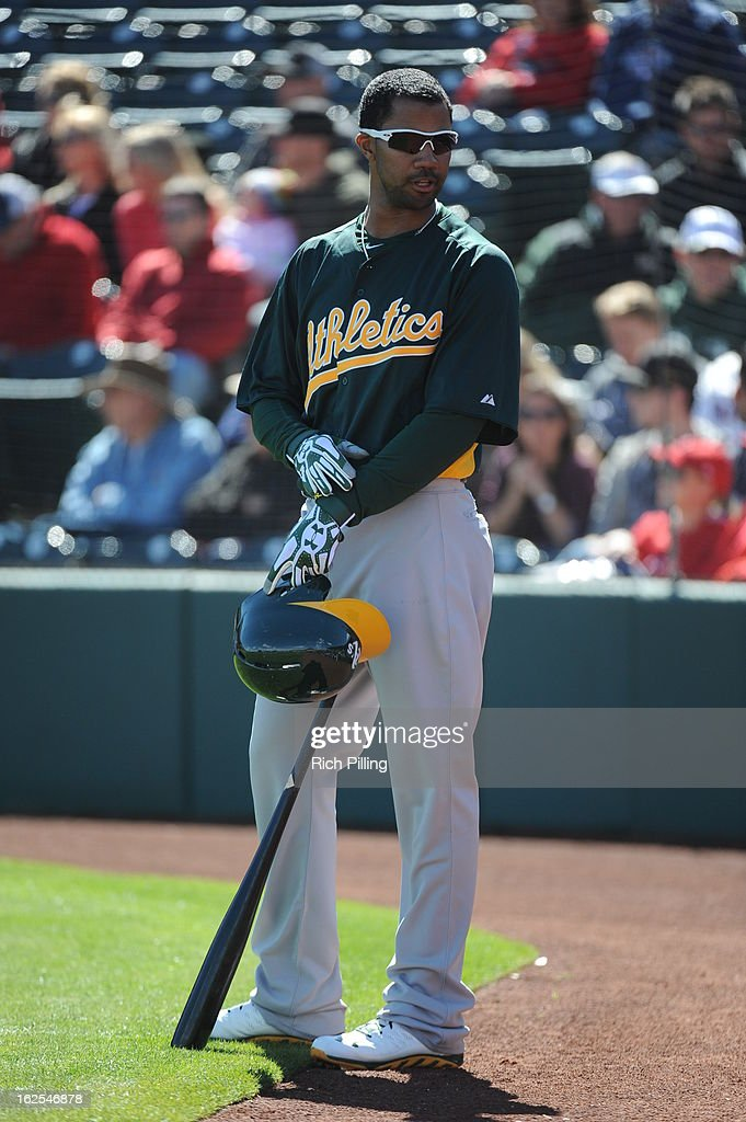 Chris Young #25 of the Oakland Athletics is seen in the on deck circle during the game against the Los Angeles Angeles of Anaheim on February 24, 2013 at Tempe Diablo Stadium in Tempe, Arizona. The Athletics defeated the Angels 7-5.