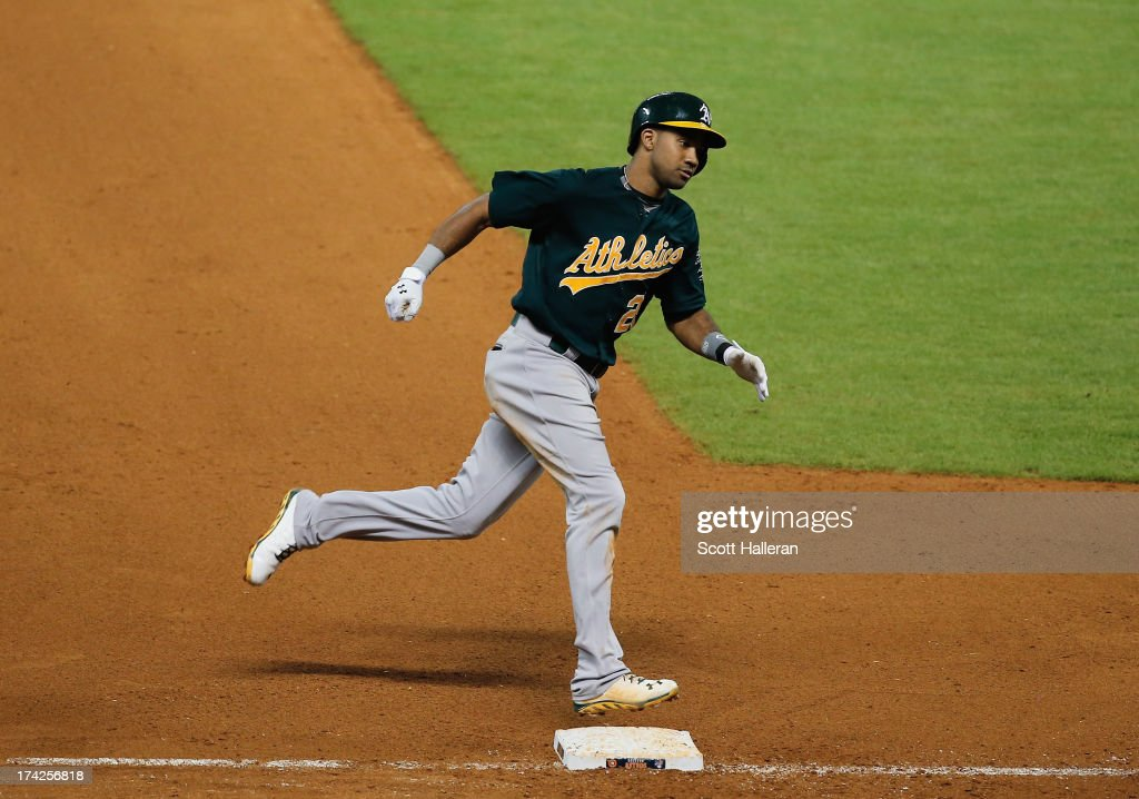 Chris Young #25 of the Oakland Athletics rounds third base after hitting a solo home run in the seventh inning against the Houston Astros at Minute Maid Park on July 22, 2013 in Houston, Texas.