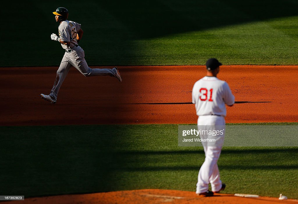 Chris Young #25 of the Oakland Athletics trots around second base after hitting a three-run home run in the fourth inning off of Jon Lester #31 of the Boston Red Sox during the game on April 24, 2013 at Fenway Park in Boston, Massachusetts.