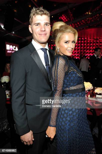 Chris Zylka and Paris Hilton at the MOCA Gala 2017 honoring Jeff Koons at The Geffen Contemporary at MOCA on April 29 2017 in Los Angeles California