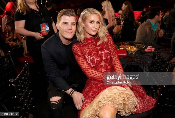 Chris Zylka and Paris Hilton attend the 2018 iHeartRadio Music Awards which broadcasted live on TBS TNT and truTV at The Forum on March 11 2018 in...