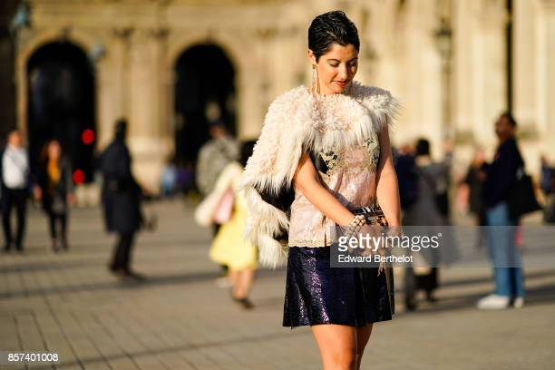 Chrisa Pappas wears a fur jacket a lace top a black skirt outside Louis Vuitton during Paris Fashion Week Womenswear Spring/Summer 2018 on October 3...