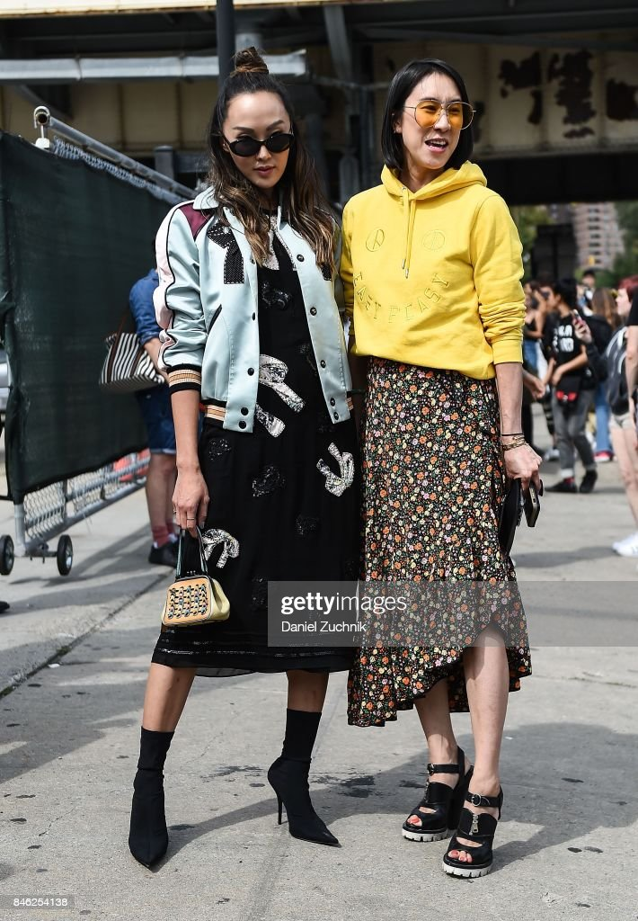 Chriselle Lim and Eva Chen are seen outside the Coach show during New York Fashion Week: Women's S/S 2018 on September 12, 2017 in New York City.