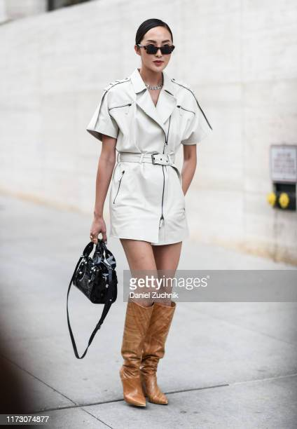 Chriselle Lim is seen wearing a Longchamp outfit and brown cowboy boots outside the Longchamp show during New York Fashion Week S/S20 on September 07...