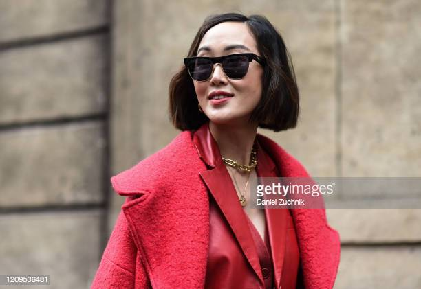 Chriselle Lim is seen wearing a red Altuzarra coat and outfit outside the Altuzarra show during Paris Fashion Week: AW20 on February 29, 2020 in...
