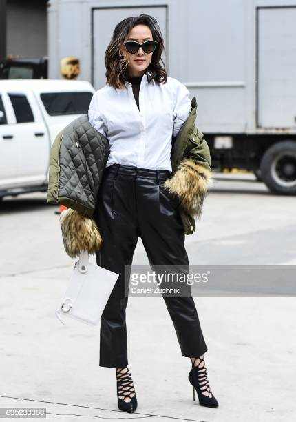 Chriselle Lim is seen wearing a white button down top green with fur coat and black leather pants outside of the Proenza Schouler show during New...