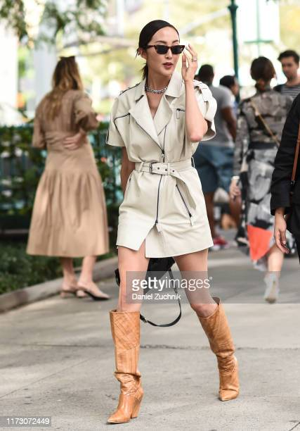 Chriselle Lim is seen wearing a white Longchamp dress and brown cowboy boots outside the Longchamp show during New York Fashion Week S/S20 on...